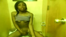teen pleasures herself at toilet